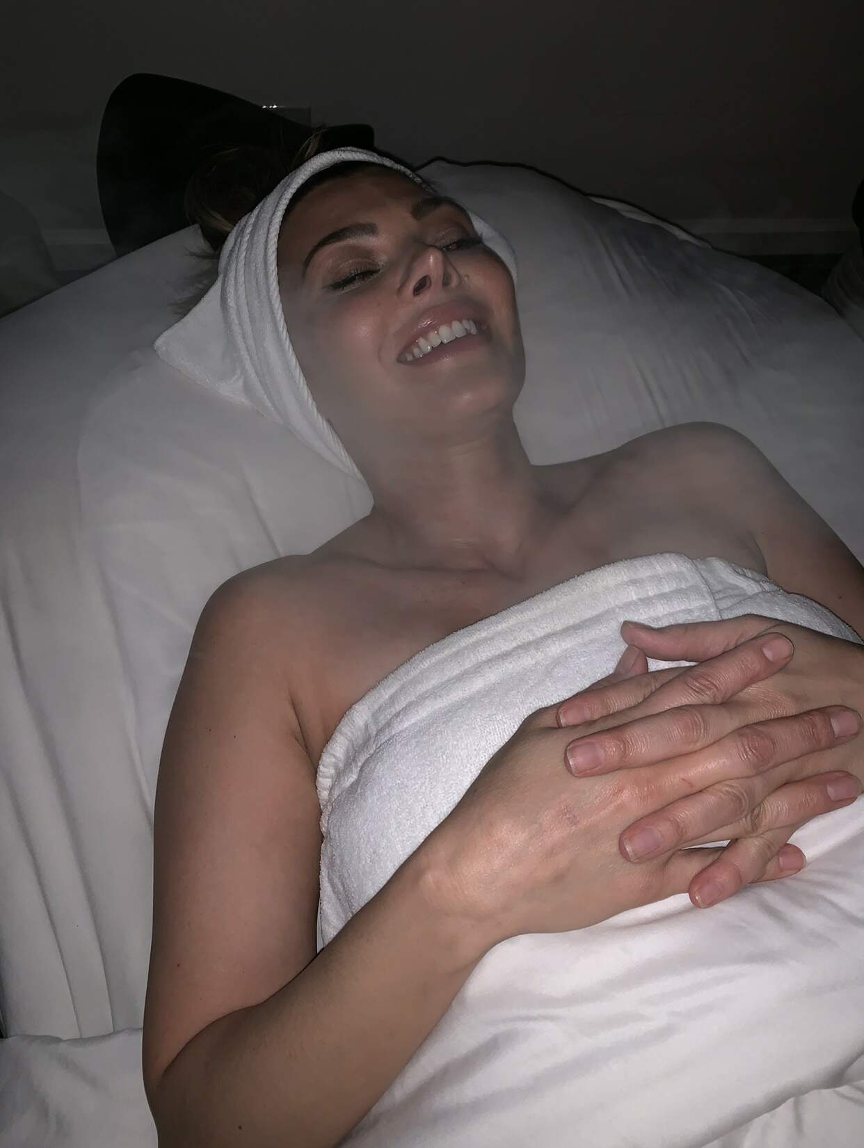 Ali laying down relaxing for massage oil article